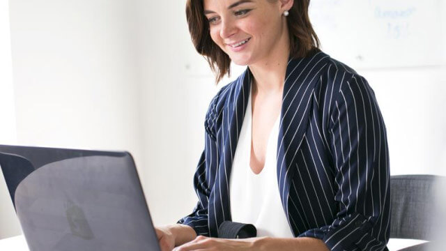 modern-woman-at-laptop-working-1